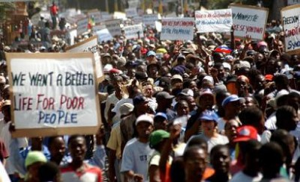Thousands of poor Haitians protest to demand their president resign immediately.